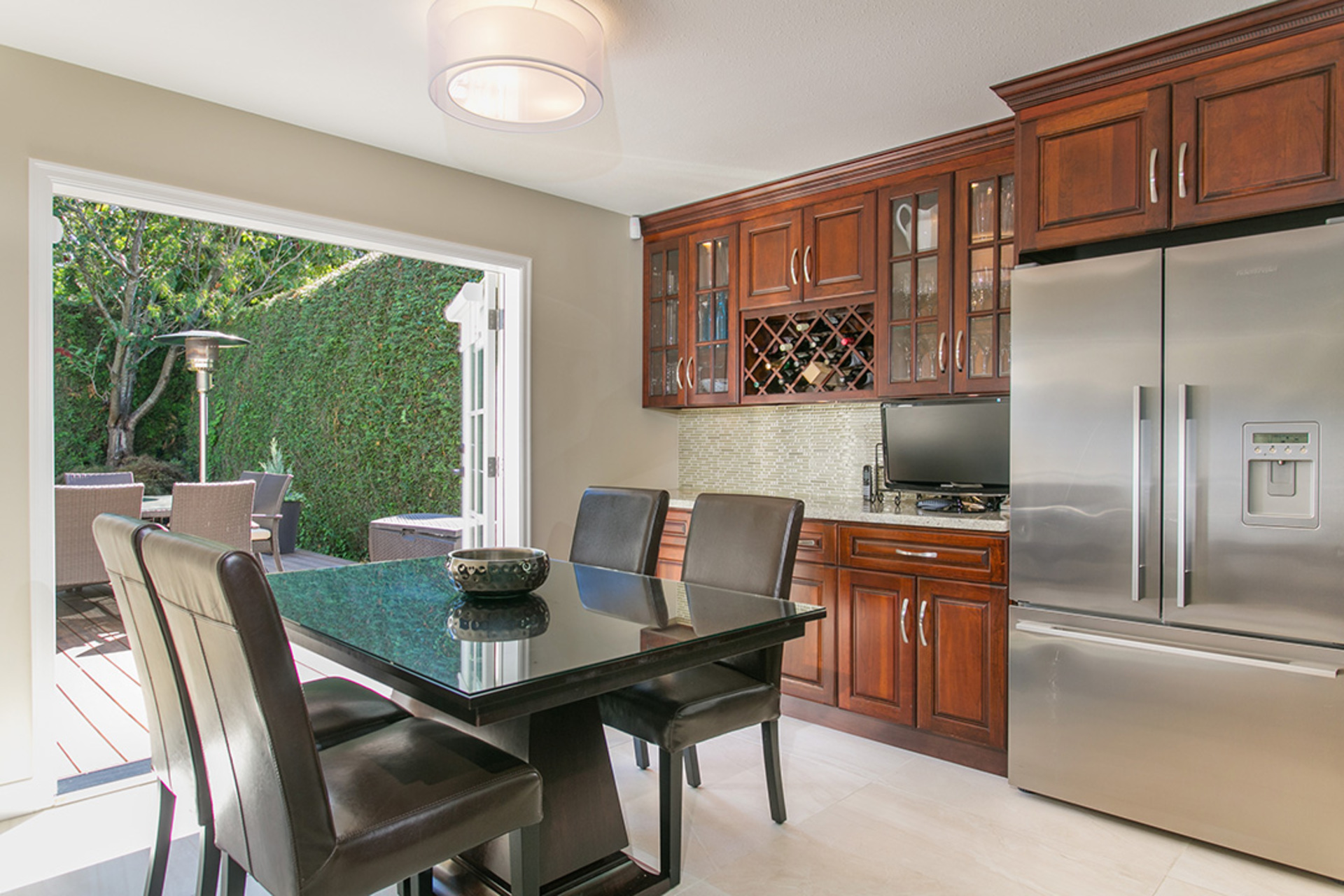 French doors open to a stunning back garden at 6726 Arbutus Street, Southlands, Vancouver West