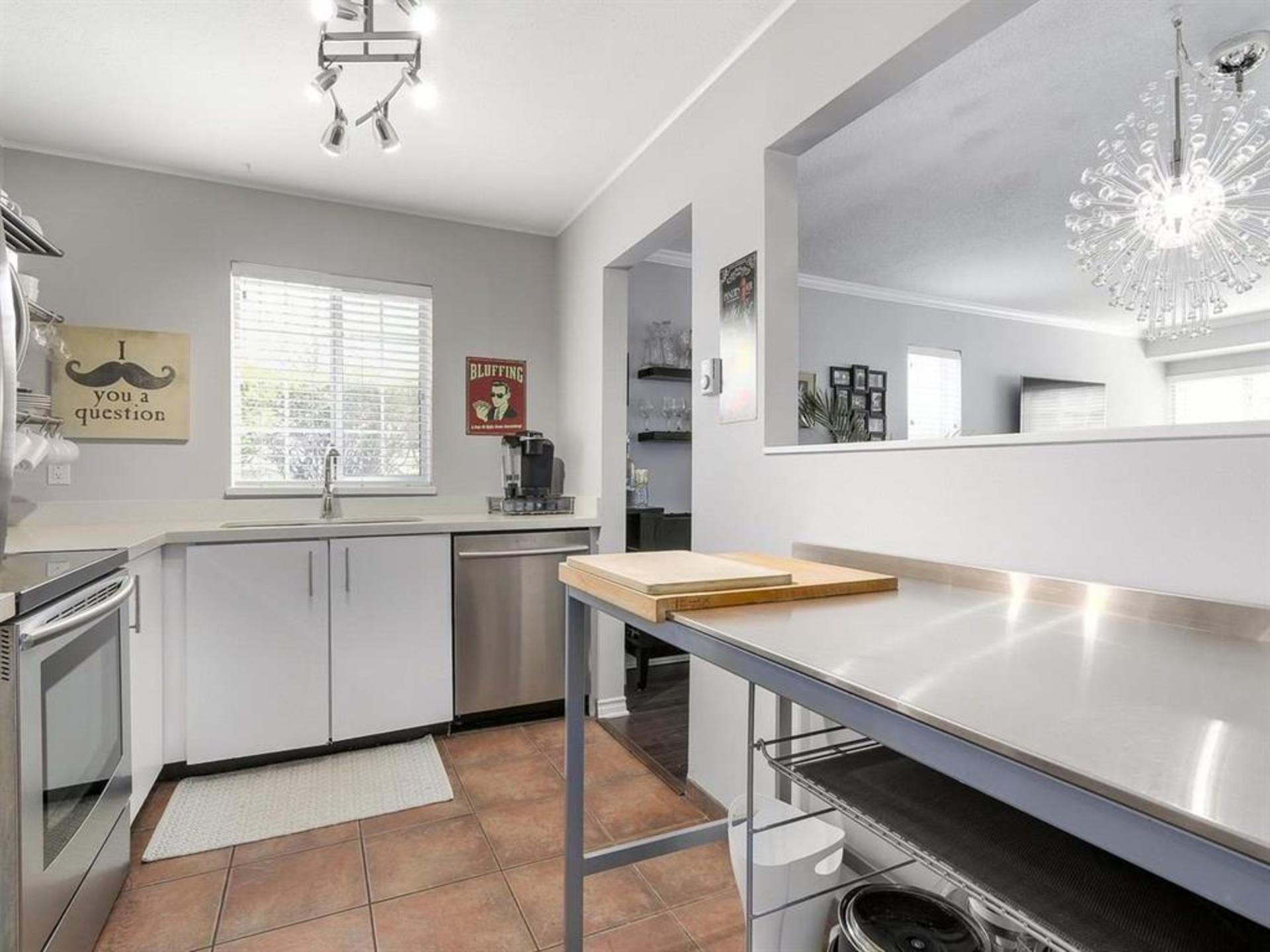 Kitchen with great counter space and window at 108 - 1386 73, Marpole, Vancouver West