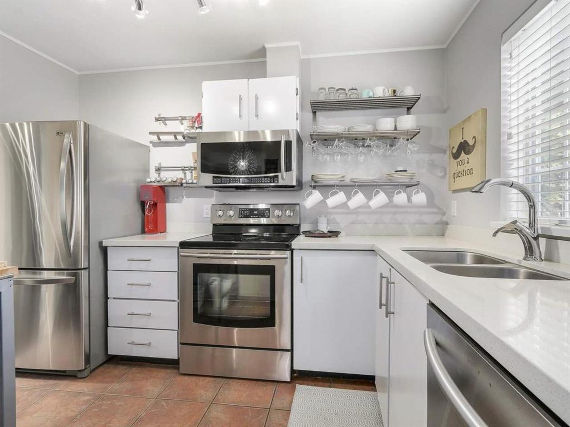 kitchen updated appliances at 108 - 1386 73, Marpole, Vancouver West