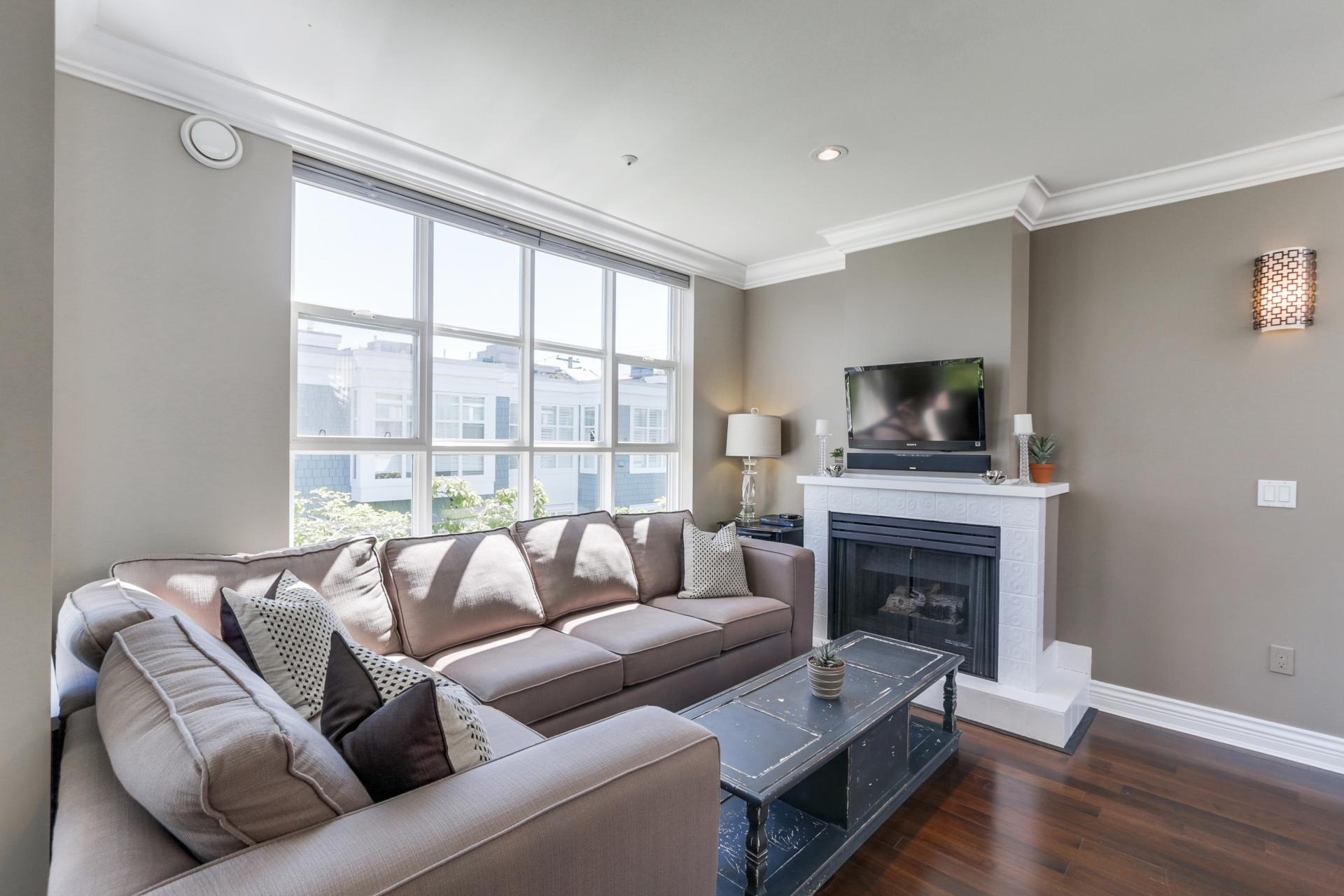Living Room and Cozy Fireplace at 205 - 669 West 7th Avenue, Fairview VW, Vancouver West