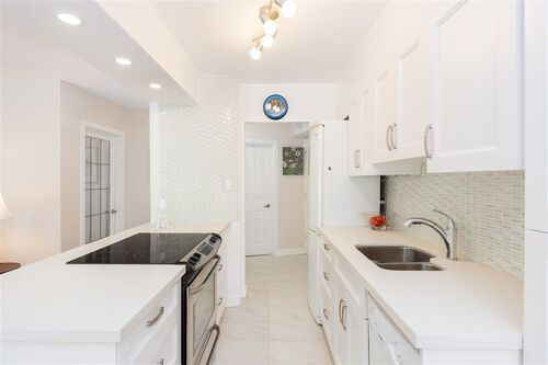 e4affd5f3ac44b2a57c1a1c40a0b6cdd at 104 - 1930 Marine Drive, Ambleside, West Vancouver