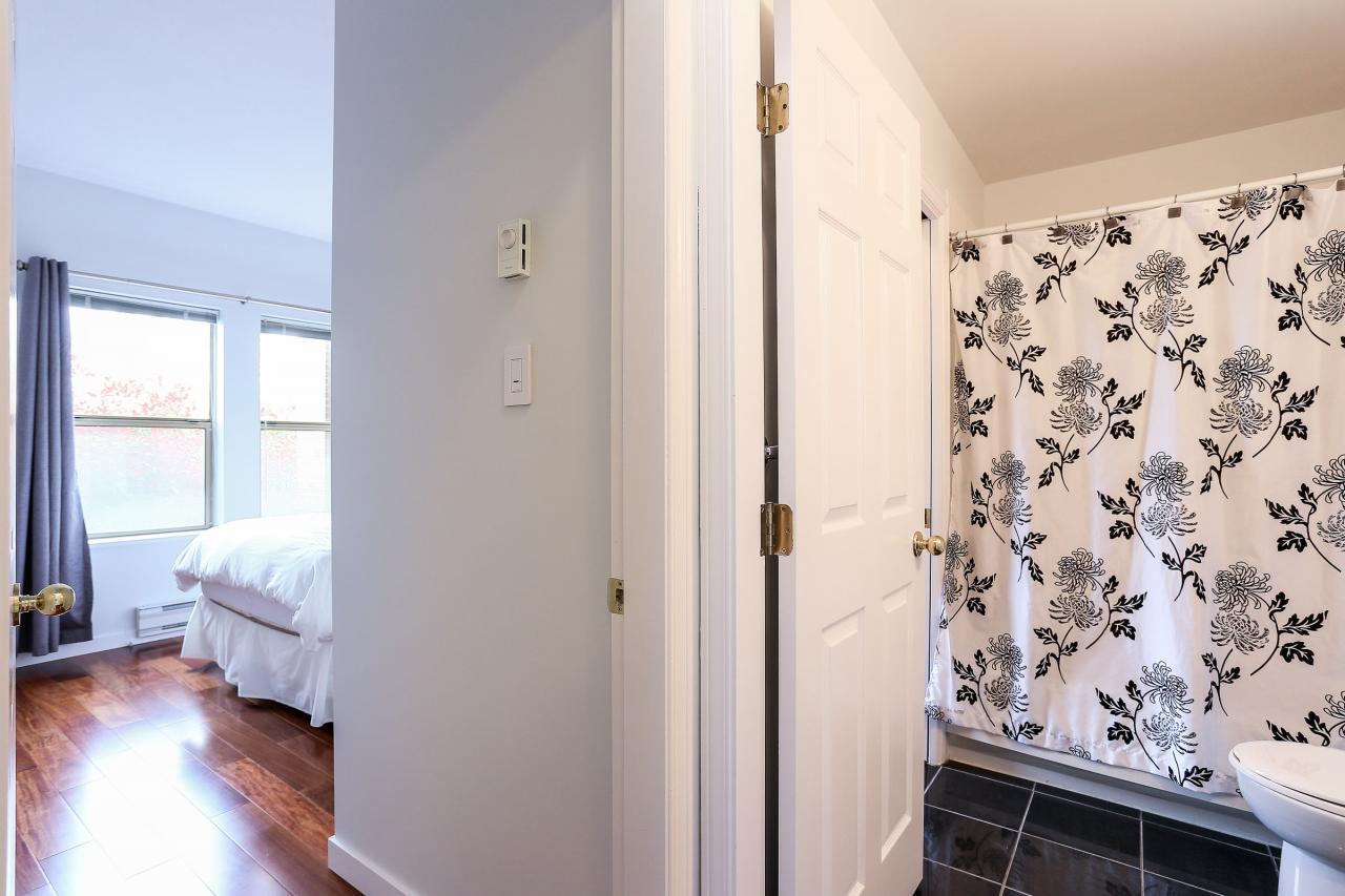 Walk through bathroom at 105 - 1591 Booth Avenue, Maillardville, Coquitlam