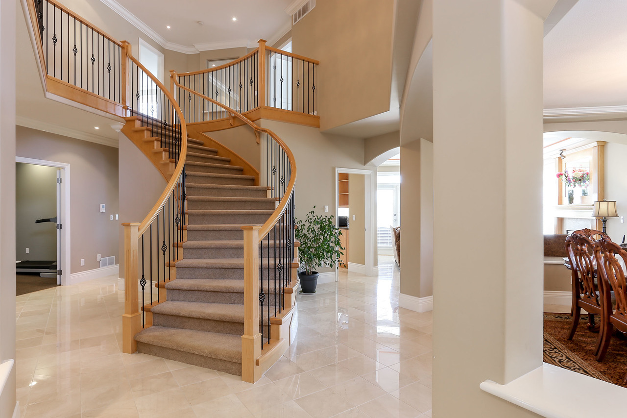 Foyer with sweeping staircase to upper level, white Italian marble flooring throughout main floor. at 1709 Augusta Place, Westwood Plateau, Coquitlam