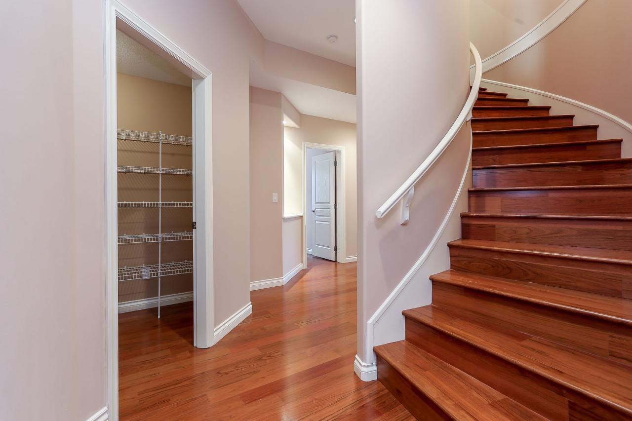 Sweeping staircase to walk-out basement. at 1709 Augusta Place, Westwood Plateau, Coquitlam