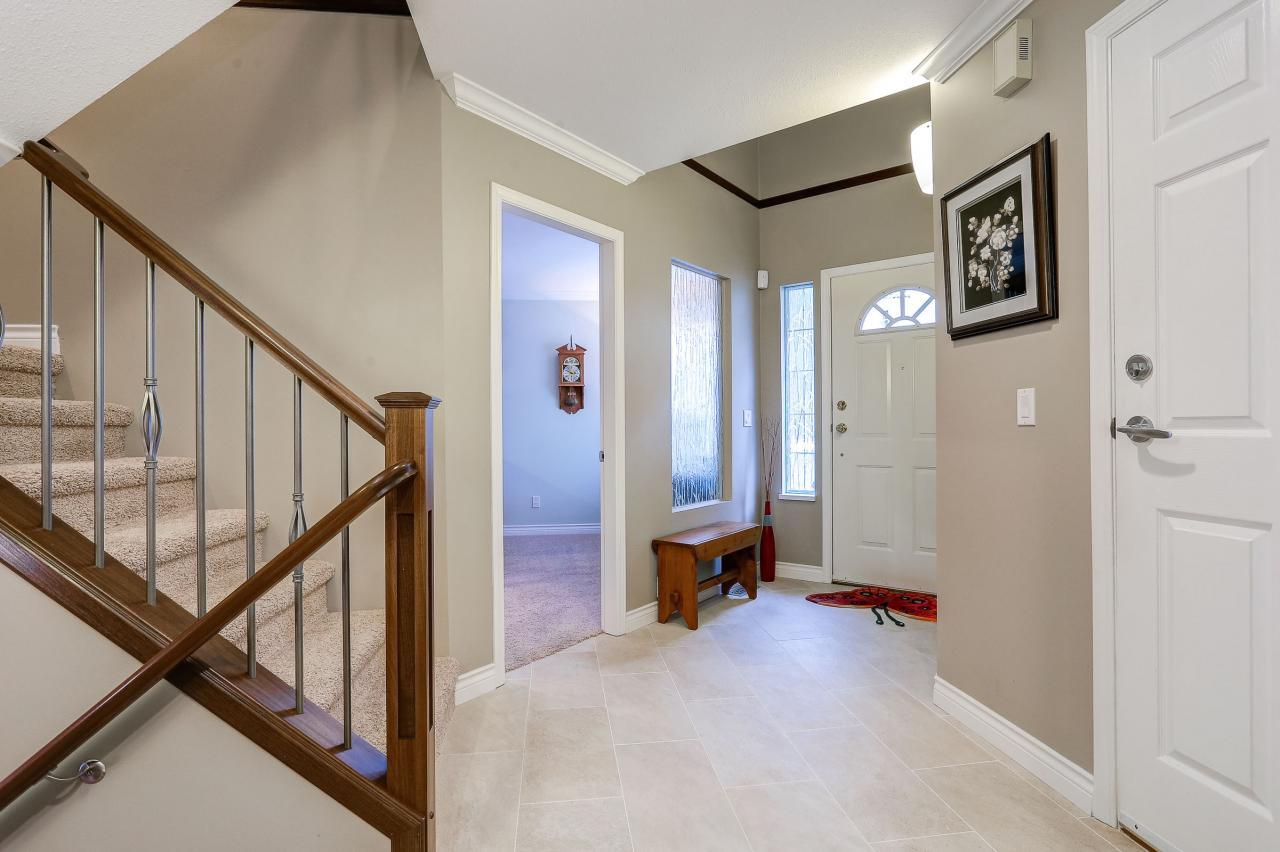 Foyer and door to den at 9 - 101 Parkside Drive, Heritage Mountain, Port Moody