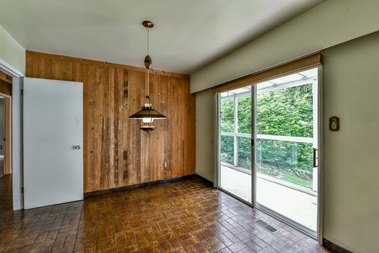 Eating Area with sliding windows opening to deck. at 924 Fresno Place, Harbour Place, Coquitlam