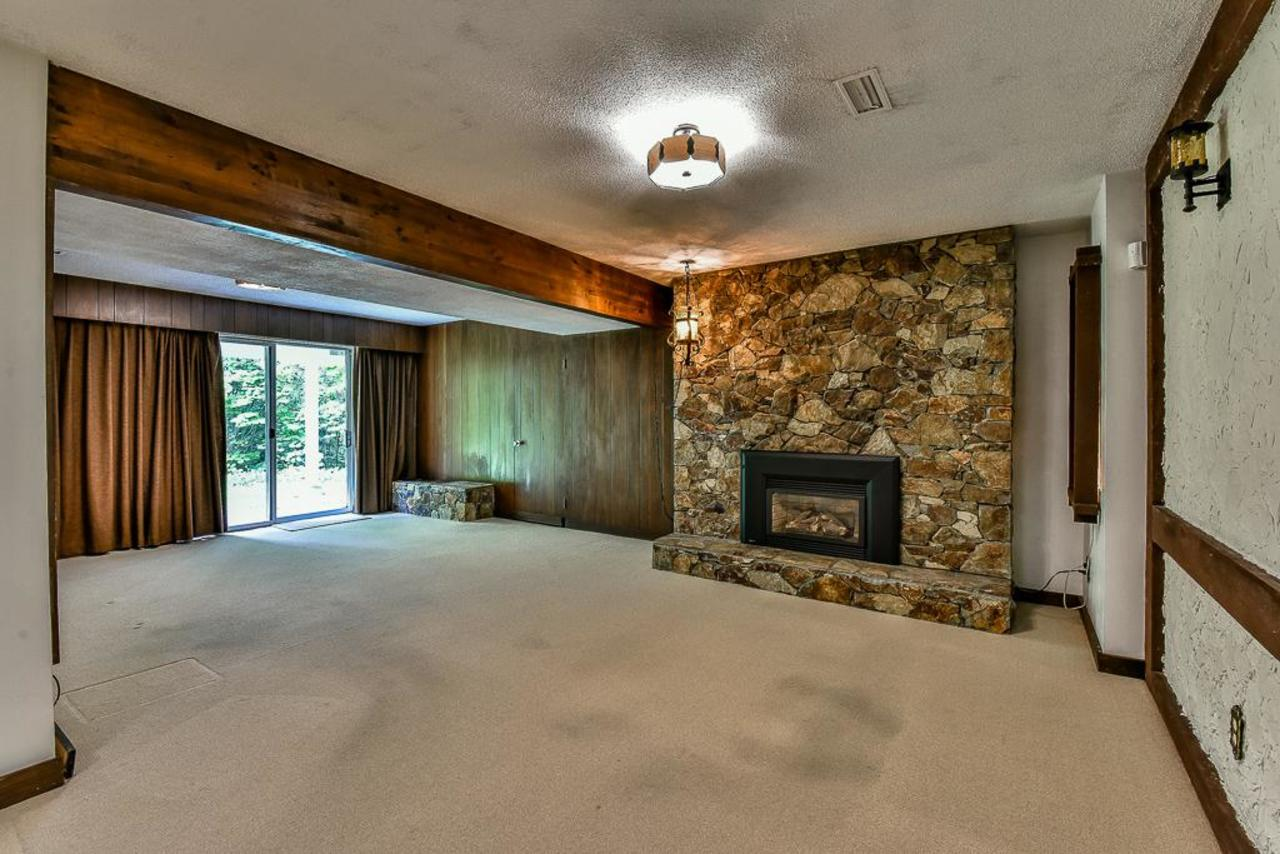 Basement rec room with sliding glass doors to covered patio and back yard. at 924 Fresno Place, Harbour Place, Coquitlam