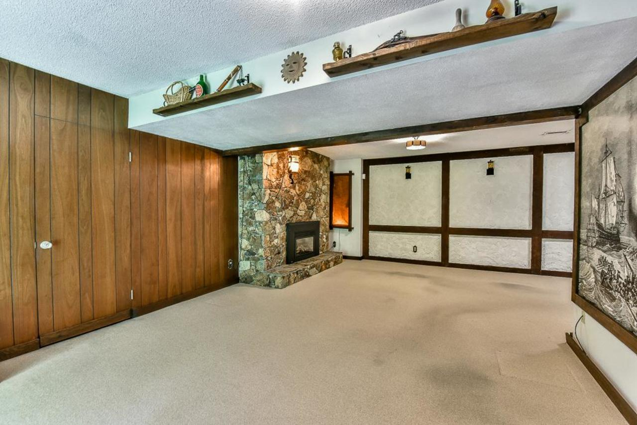 Basement rec room with gas fireplace. at 924 Fresno Place, Harbour Place, Coquitlam