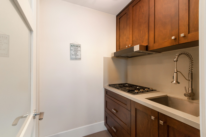 wok/prep kitchen which includes a pantry behind  at 1328 Inglewood Avenue, Ambleside, West Vancouver