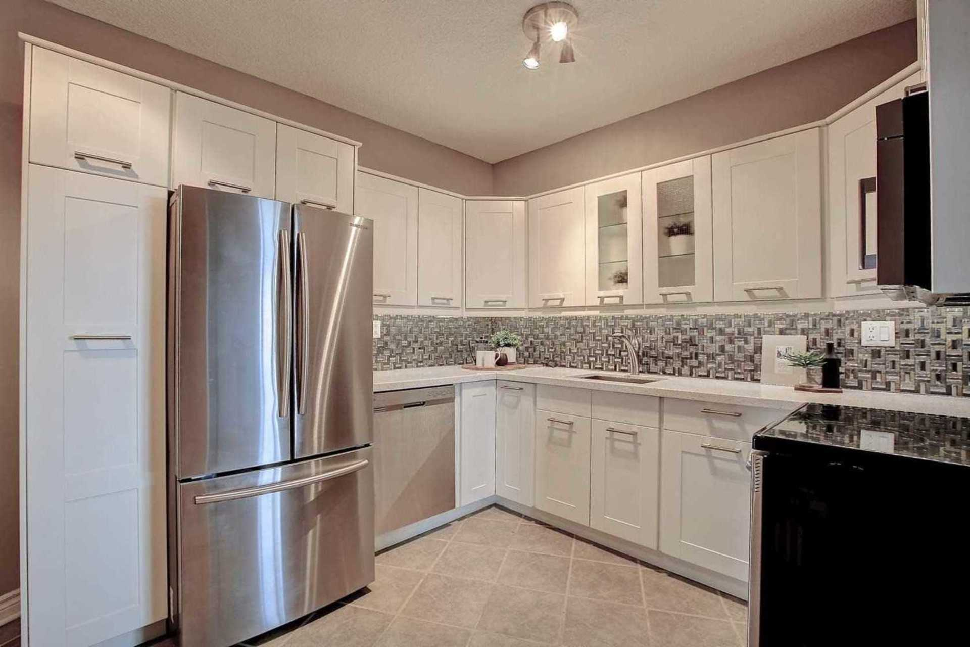 Kitchen to Family Room at 1809 - 5250 Lakeshore Road, Appleby, Burlington