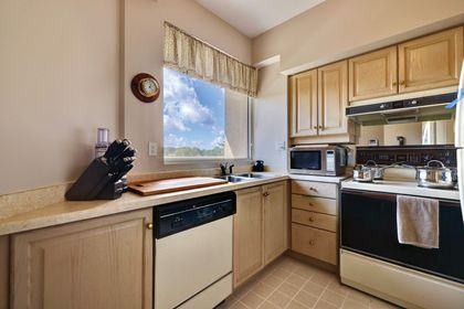 Kitchen with View at 403 - 2511 Lakeshore Road West, Bronte West, Oakville