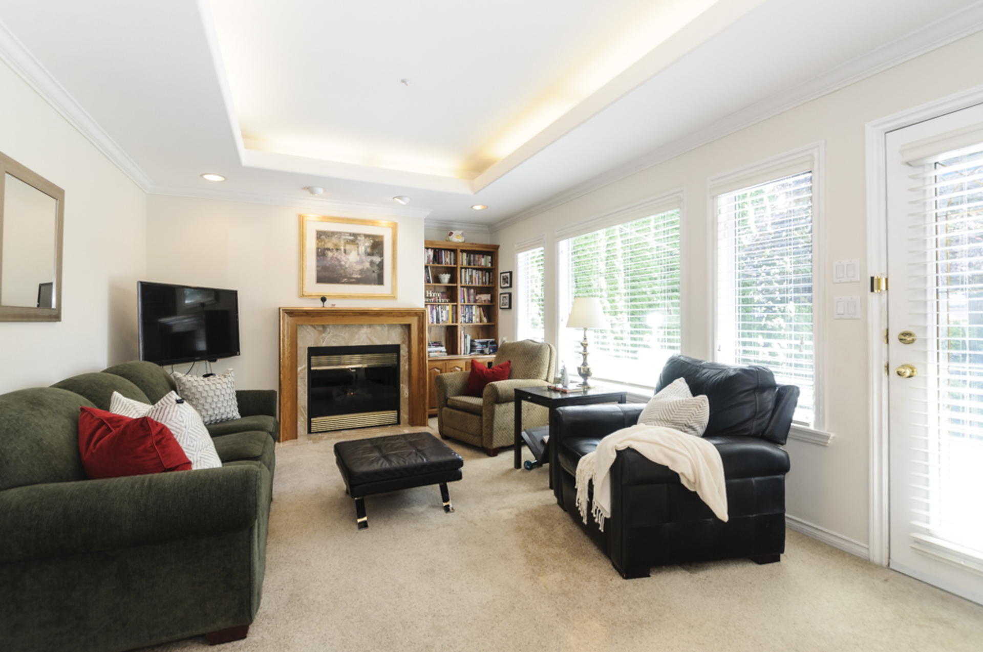Family room with gas fireplace that opens to the back deck at 1178 West 42nd Avenue, South Granville, Vancouver West
