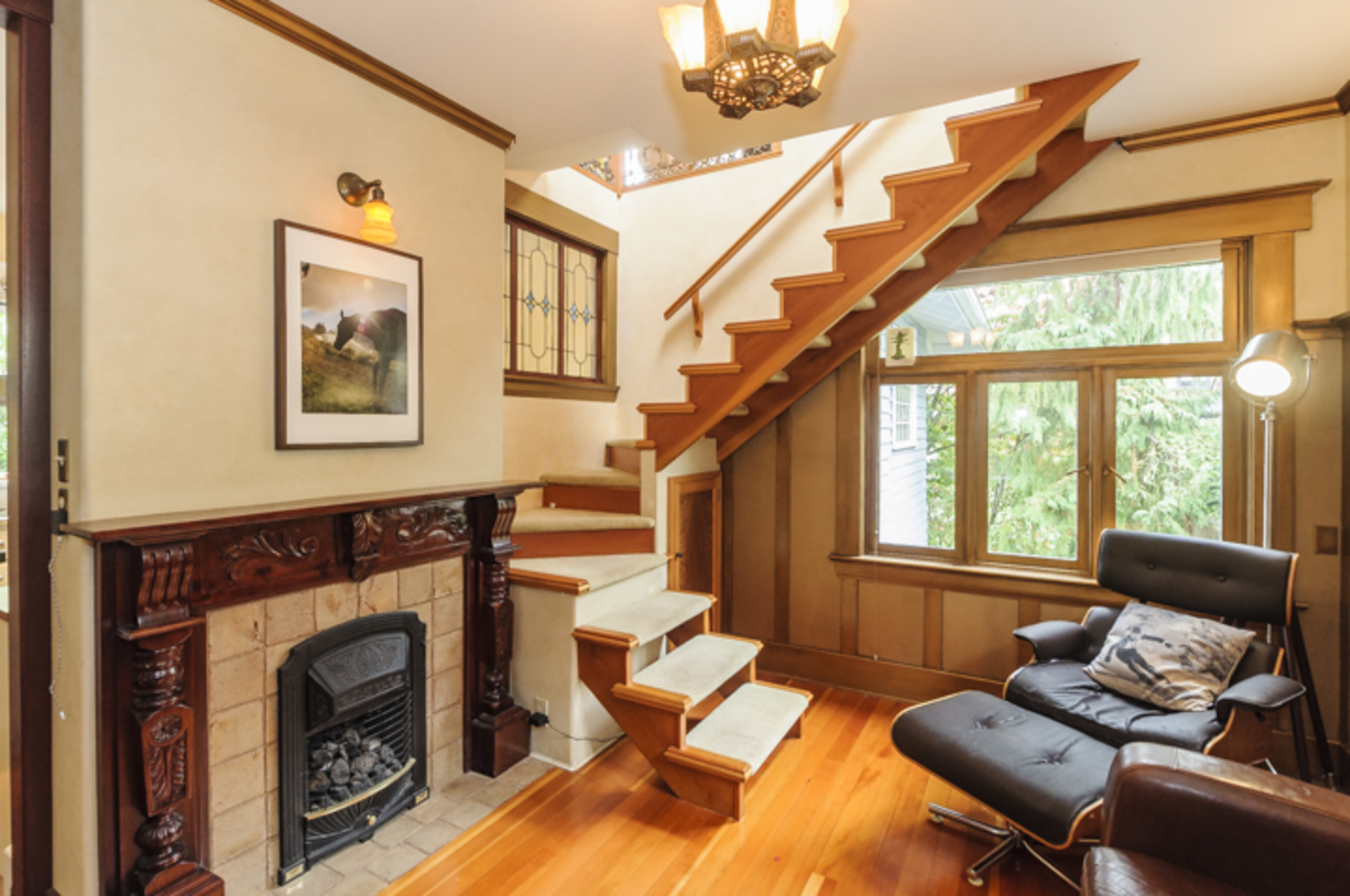 Incredible custom wood surround on this classic gas fireplace at 2617 West 7th Avenue, Kitsilano, Vancouver West
