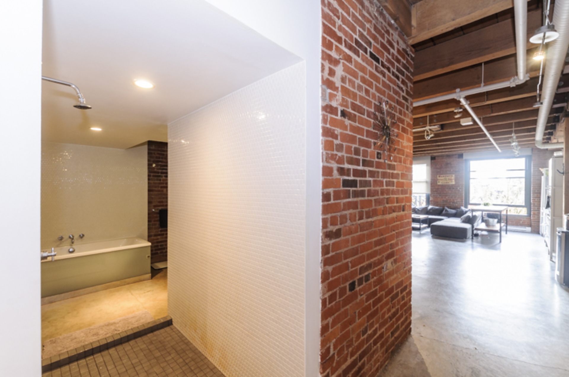 Exposed brick walls at every turn at 314 - 55 East Cordova Street, Downtown VE, Vancouver East