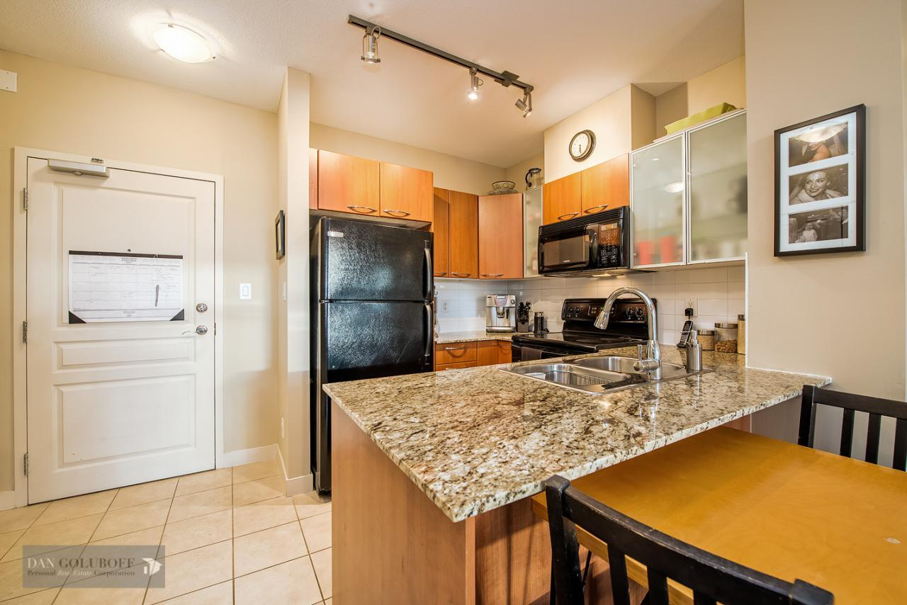 Kitchen with granite counter at 302 - 4078 Knight Street, Knight, Vancouver East