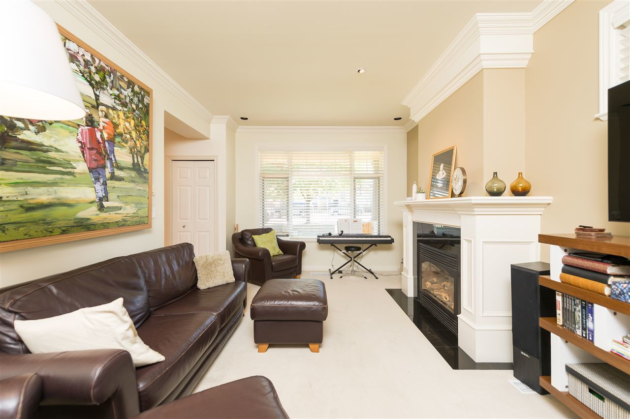 Bright Duplex Burnaby living area/fireplace at 4327 Albert Street, Vancouver Heights, Burnaby North
