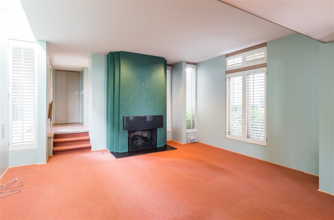 Gas fireplace in family room-open concept to ktichen at 2456 Bellevue Avenue, Dundarave, West Vancouver