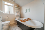 Upstairs bathroom with soak tub at 5085 Inverness Street, Fraser VE, Vancouver East
