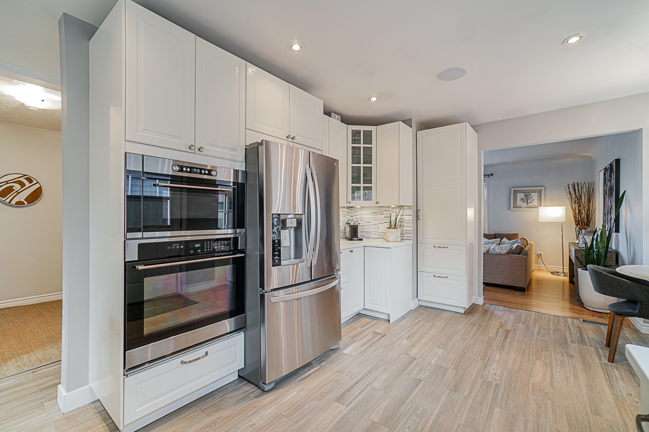 Stainless steel appliances-gas cooktop at 5085 Inverness Street, Fraser VE, Vancouver East