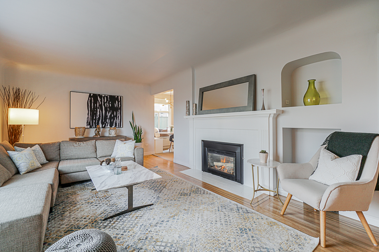 Great room with gas fireplace at 5085 Inverness Street, Fraser VE, Vancouver East