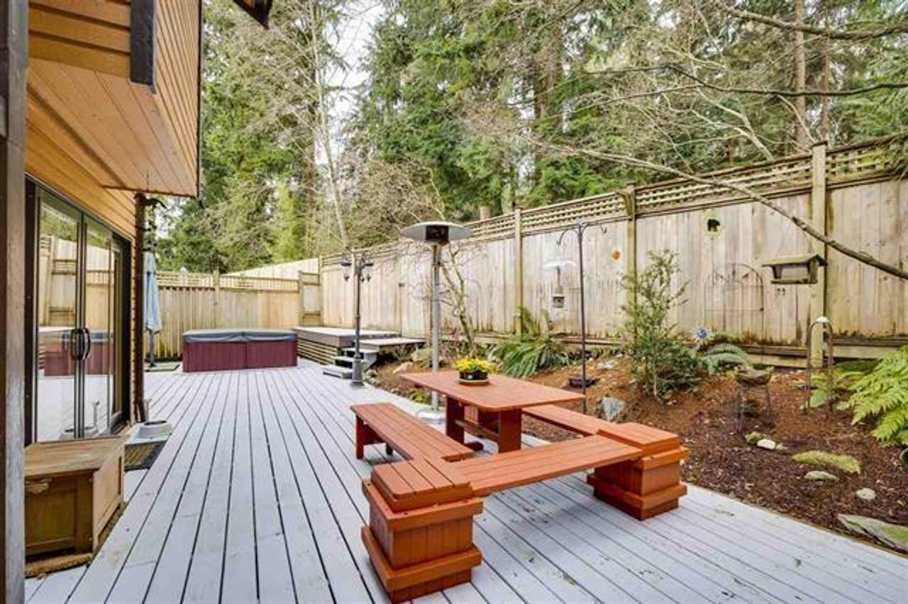 Fenced backyard with hot tub at 1229 Caledonia Avenue, Deep Cove, North Vancouver
