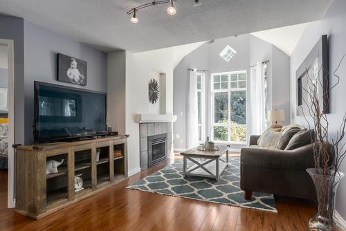 living at 411 - 9979 140th Street, Surrey
