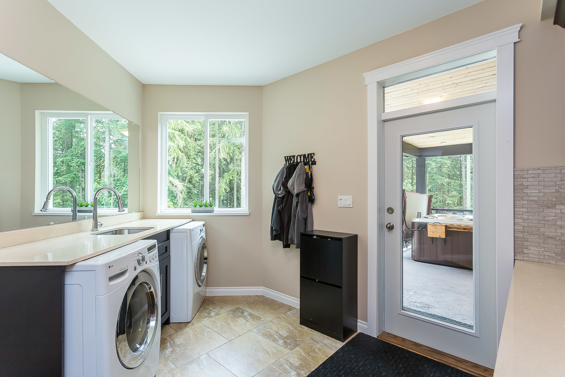 Mud Room/Laundry on Main at 1408 Crystal Creek Drive, Anmore, Port Moody
