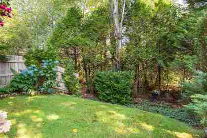 Backyard bordering greenspace at 7427 Echo Place, Champlain Heights, Vancouver East