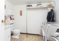 Laundry/Powder Room at 7427 Echo Place, Champlain Heights, Vancouver East