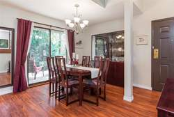 Dining Room with sliders to patio at 7427 Echo Place, Champlain Heights, Vancouver East