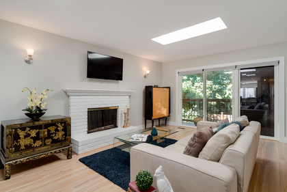 Bright Living Room with Skylights and fireplace at 1497 Harold Road, Lynn Valley, North Vancouver