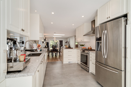 Renovated Kitchen with Stainless Appliances (gas stove) at 1497 Harold Road, Lynn Valley, North Vancouver