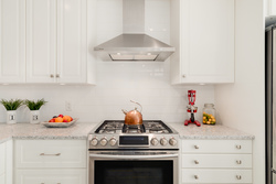 Gas stove and white kitchen at 1497 Harold Road, Lynn Valley, North Vancouver
