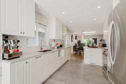 White Kitchen and stainless appliances at 1497 Harold Road, Lynn Valley, North Vancouver