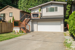 Rear View with Double Garage & BBQ Deck at 1497 Harold Road, Lynn Valley, North Vancouver