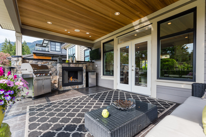 Covered Deck with Gas Fireplace | Edgemont Family Home | North Vancouver at 4565 Ranger Avenue, Canyon Heights NV, North Vancouver