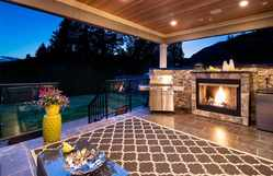 Covered Deck with Gas Fireplace | Edgemont Family Home | Twilight at 4565 Ranger Avenue, Canyon Heights NV, North Vancouver