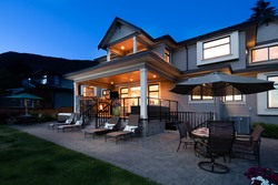 Rear Exterior Patio & Covered Deck | Edgemont Family Home | Twilight at 4565 Ranger Avenue, Canyon Heights NV, North Vancouver