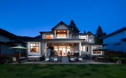 Rear Exterior | Edgemont Family Home | Twilight at 4565 Ranger Avenue, Canyon Heights NV, North Vancouver