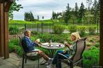 Bear Mountain Homeowners enjoying views of the golf course. at 104 - 1454 Bear Mountain Parkway, Bear Mountain, Langford