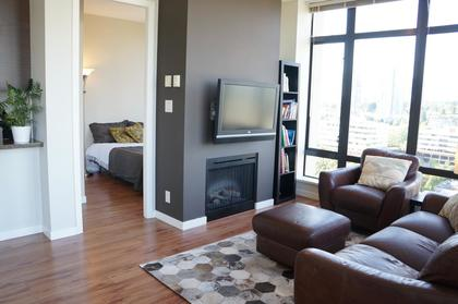 A cozy fireplace and living area at 1606 - 2355 Madison Avenue, Brentwood Park, Burnaby North