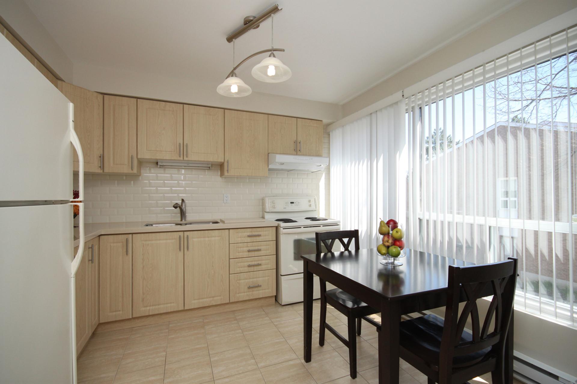 Kitchen at 3 - 3409 St. Clair Avenue E, Clairlea-Birchmount, Toronto