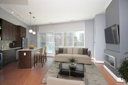 Virtually Staged Living Room & Kitchen at S209 - 112 George Street, Moss Park, Toronto