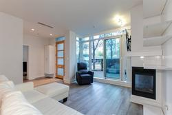 Light filled and open living room with gas fireplace at 491 Broughton, Coal Harbour, Vancouver West