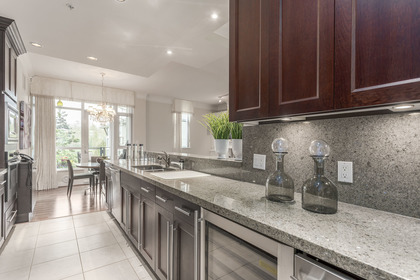 Chef's kitchen - updated granite countertops at 708 - 4685 Valley Drive, Quilchena, Vancouver West