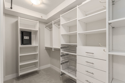 Large walk-in closet off the Master Bedroom with built in safe at 708 - 4685 Valley Drive, Quilchena, Vancouver West