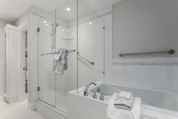 Enclosed toilet closet, glass enclosed shower and soaker tub in master ensuite bath at 708 - 4685 Valley Drive, Quilchena, Vancouver West