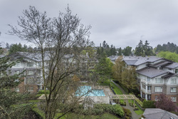 Western balcony overlooks the swimming pool at 708 - 4685 Valley Drive, Quilchena, Vancouver West