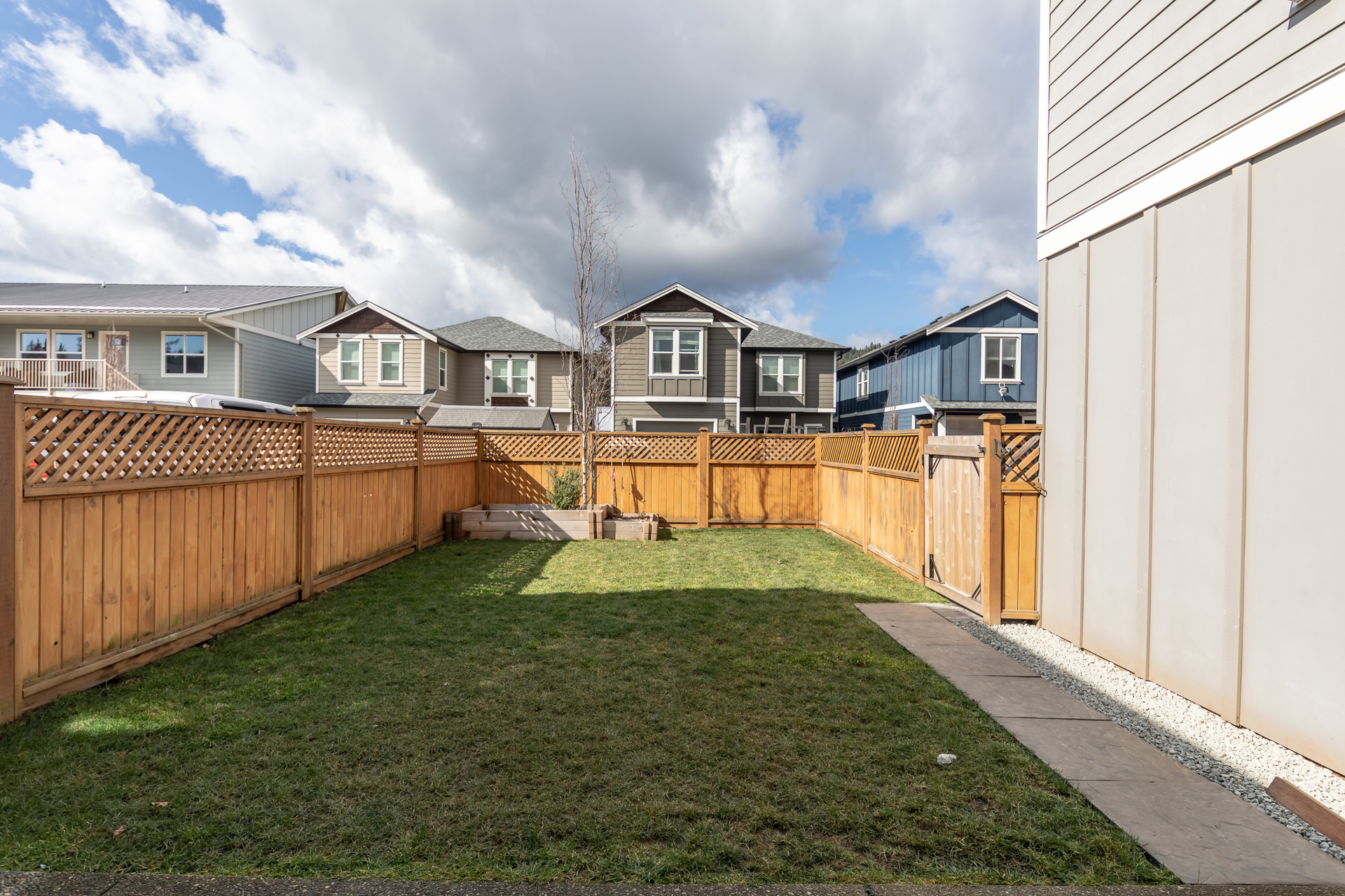 Fenced Yard With Underground Sprinklers at 3288 Merlin Road, Happy Valley, Langford