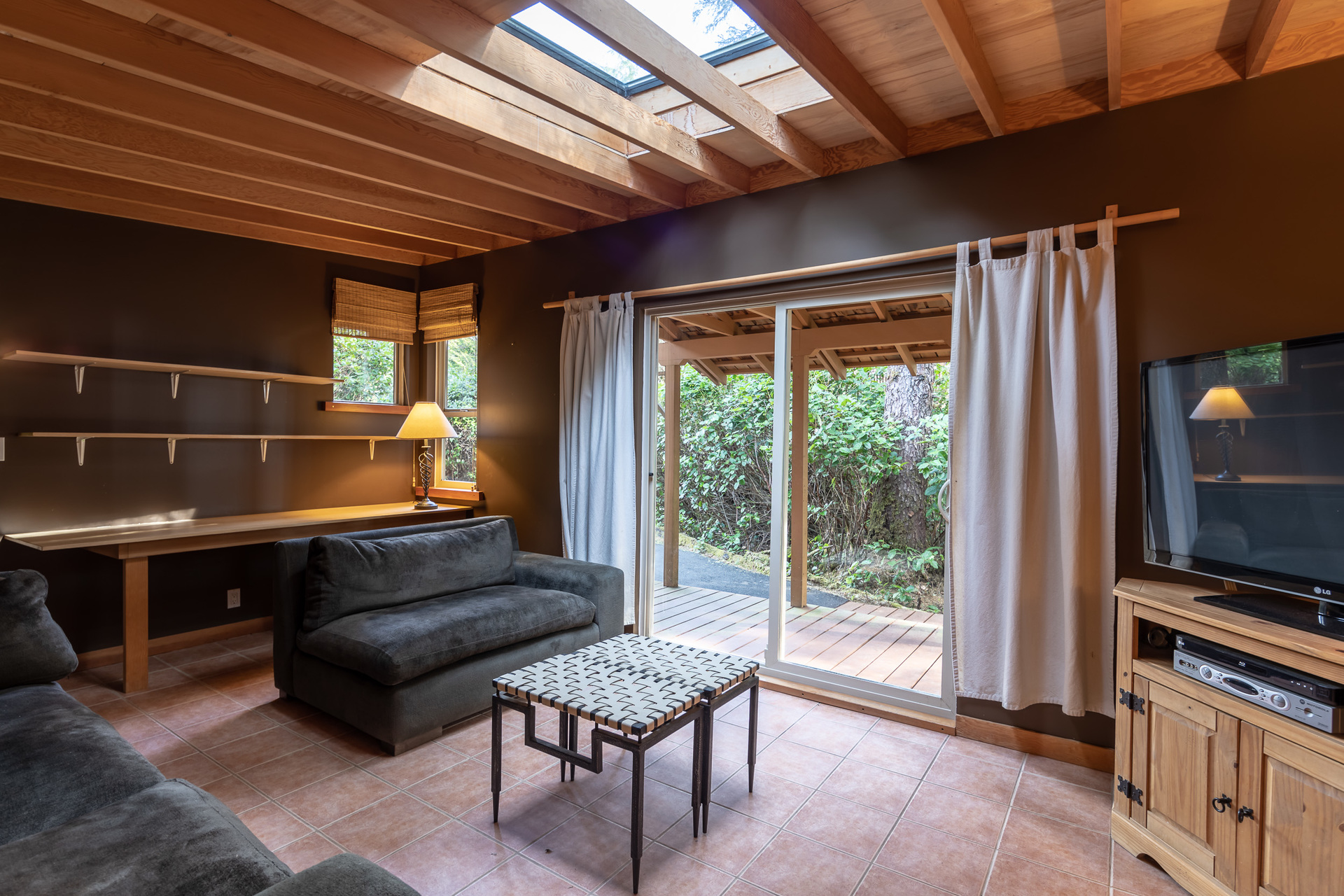 Cottage Living Room With Walkout Patio at 1277 & 1281 Lynn Road, Tofino Tofino, Vancouver Island
